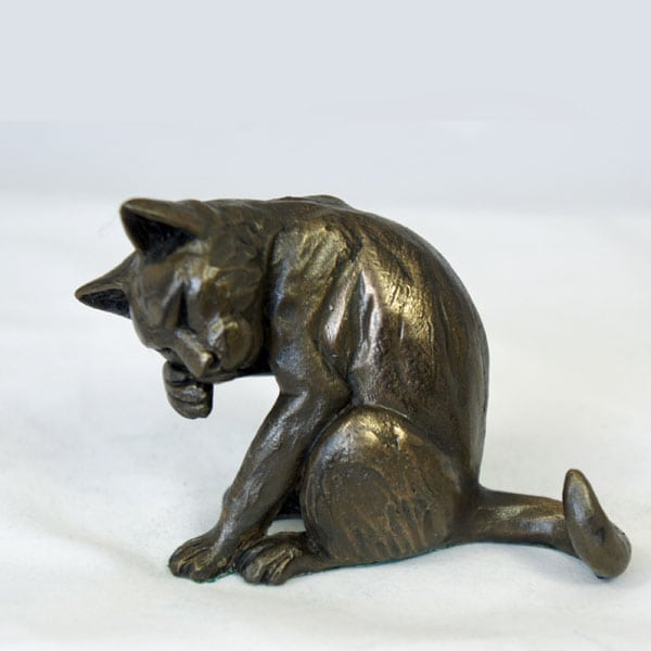bronze resin Cat washing its face