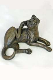 bronze resin Cat lying scratching