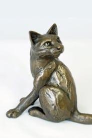 bronze resin Cat looking back