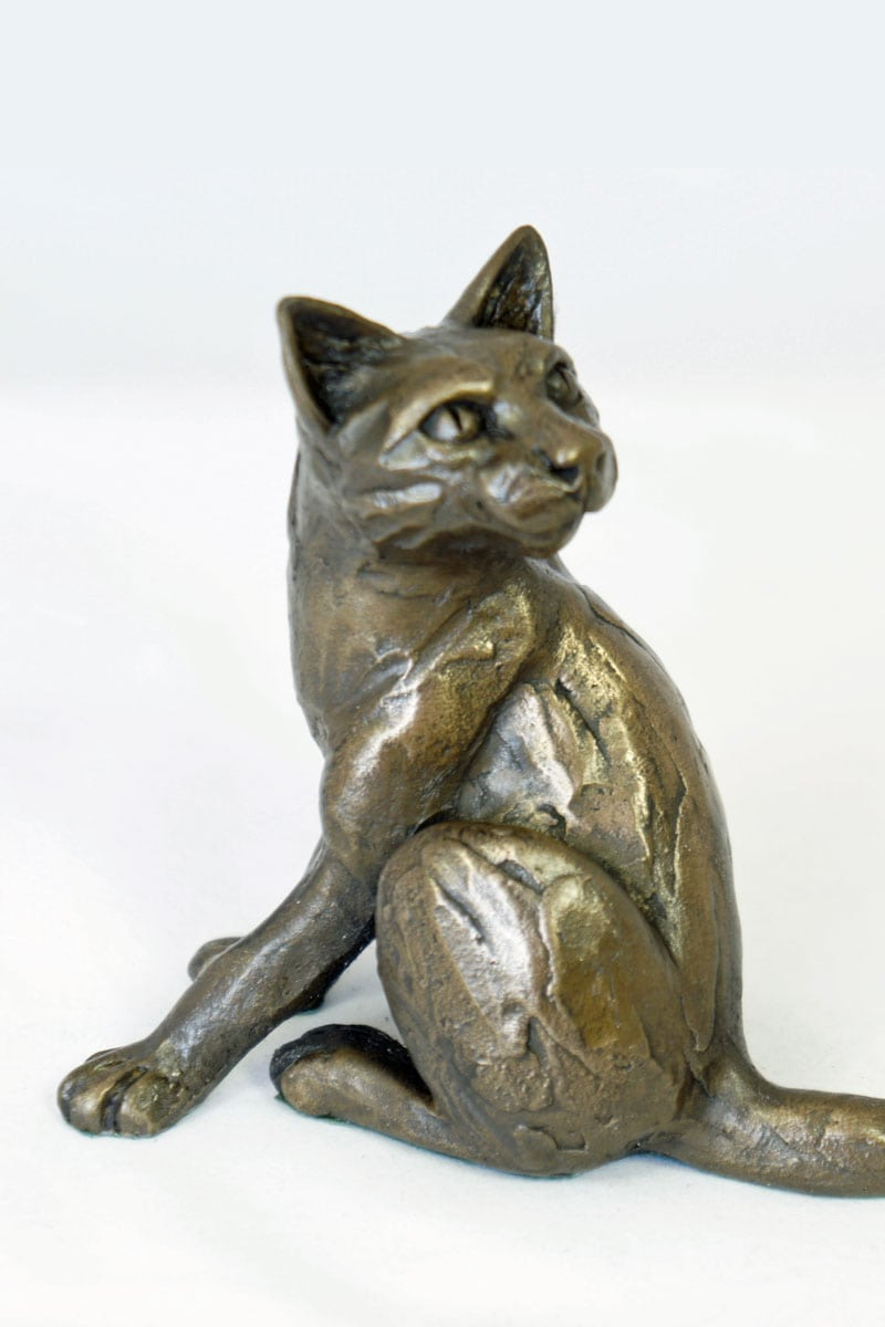 bronze resin Cat looking back