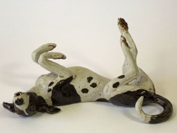 Rolling Dog with pointy toes – 'Riding a Bicycle' - ceramic clay sculpture