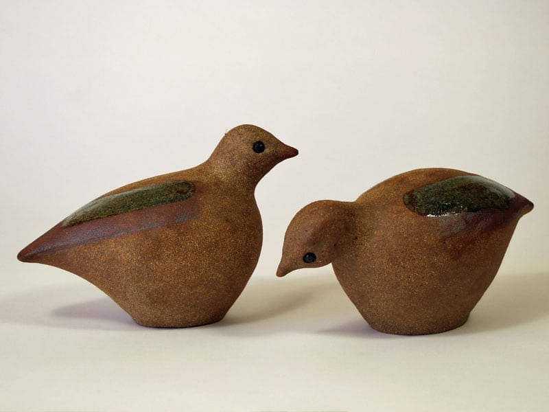 A Pair of Stoneware Grouse