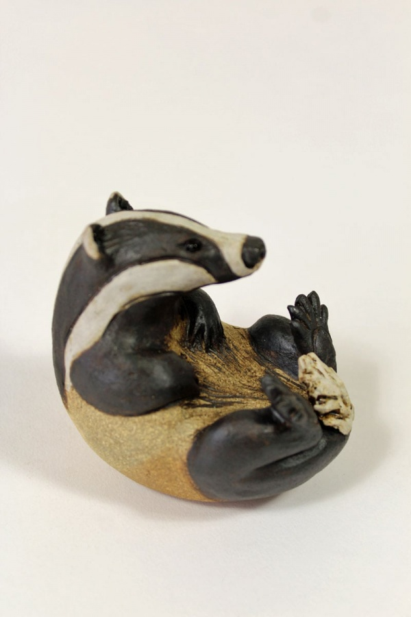 Badger scratching his chest - ceramic clay sculpture