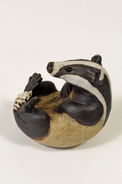 Badger with paws on his chest - ceramic clay sculpture