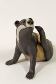 Badger Scratching his cheek - ceramic clay sculpture