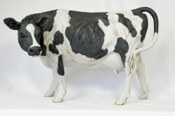 A Black and White Cow - ceramic clay sculpture