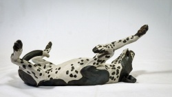 Rolling Dog, lying and stretching - ceramic clay sculpture