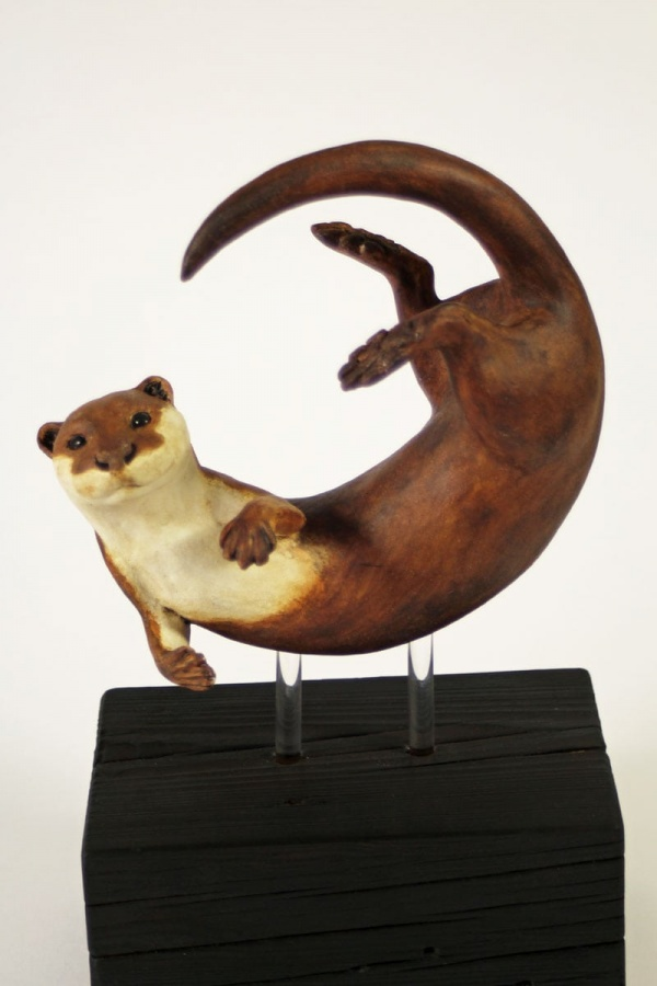 Otter, In a Spin, medium - ceramic clay sculpture
