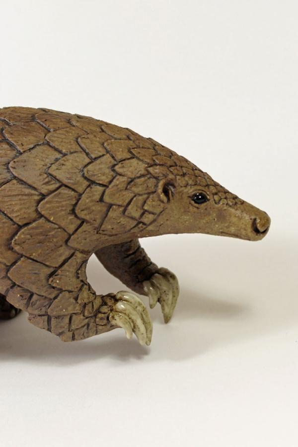 Pangolin balancing on its tail - ceramic clay sculpture