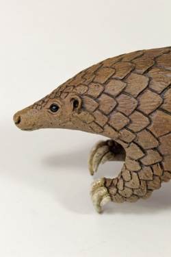 Pangolin balancing on its tail - ceramic clay sculpture