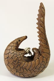 Curled up Pangolin - ceramic clay sculpture