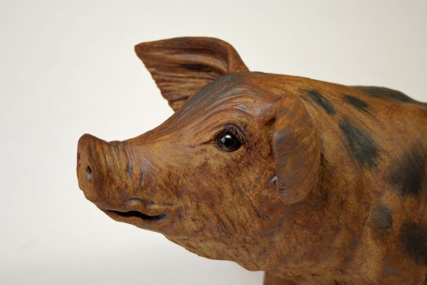 A Spotty Pig, looking right - ceramic clay sculpture