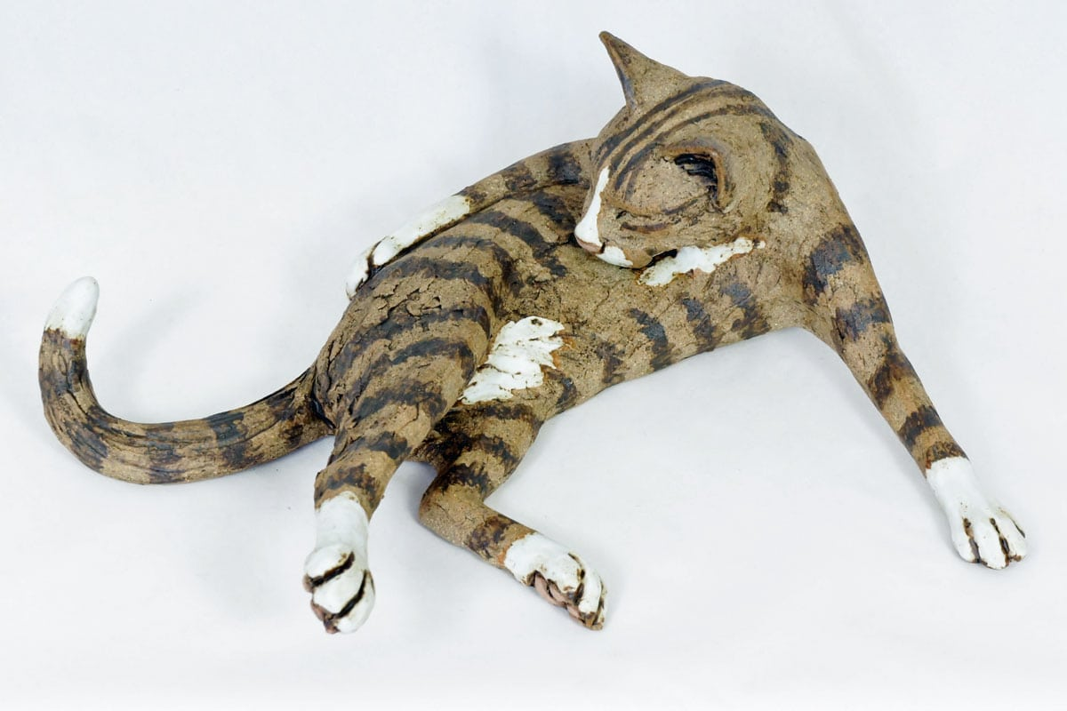 Lying Tabby Cat, Washing her side - ceramic clay sculpture