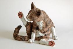 Tabby Cat, Contemplating his back leg - ceramic clay sculpture