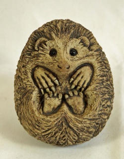 Curled Hedgehog - ceramic clay sculpture