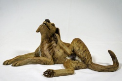 Sitting Dog scratching his chin - ceramic clay sculpture