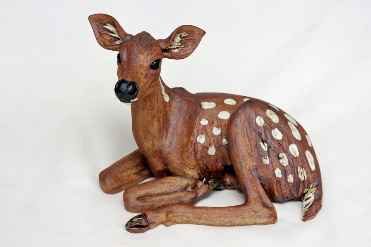 Deer Fawn, curled with its head up - ceramic clay sculpture