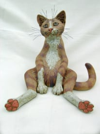 A Cat with Legs Akimbo - ceramic clay sculpture