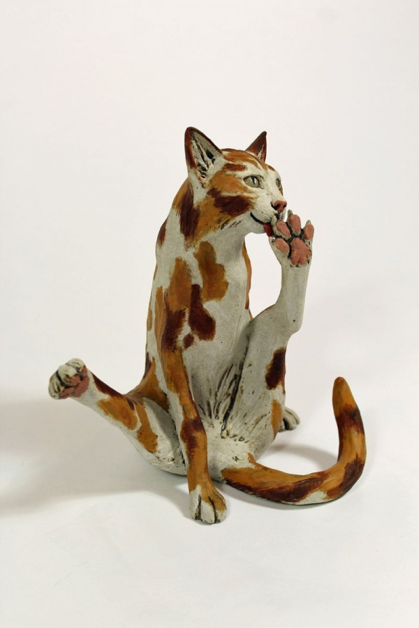 Sniggering Cat - ceramic clay sculpture