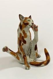 Sniggering Cat - ceramic clay sculpture