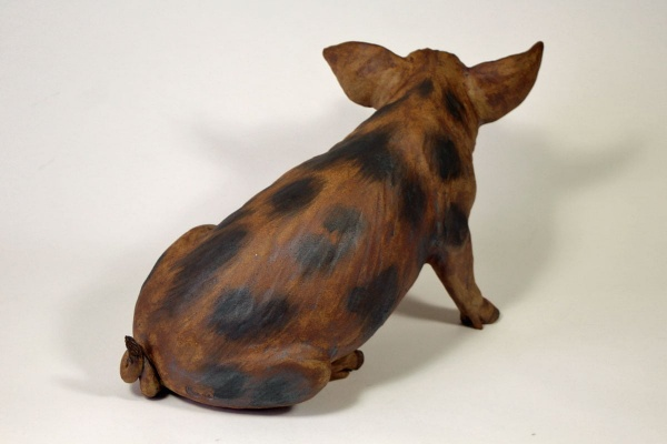 A Spotty Pig, looking left - ceramic clay sculpture
