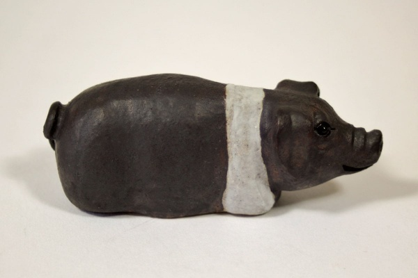 A Small Saddleback Stoneware Pig - ceramic clay pig