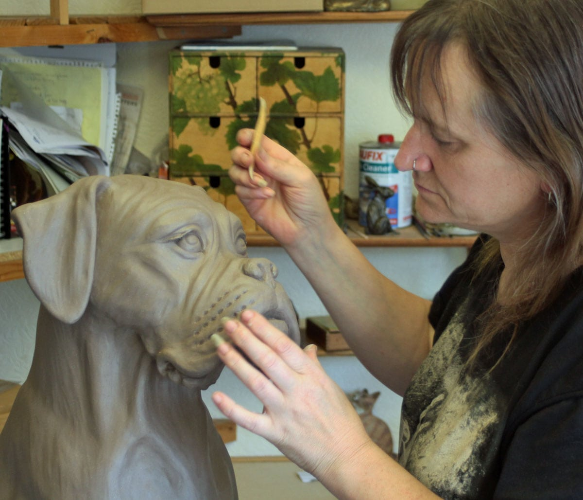 Pippa Hill working on Cassius, a life size Boxer commission